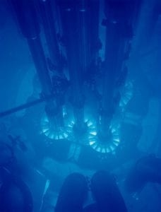 Cherenkov radiation is responsible for the blue glow of underwater nuclear reactors.